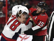 Ottawa Senators left wing Zack Smith (15) knocks off the helmet of Washington Capitals defenseman Tyler Lewington (78) as they fight during the second period of an NHL hockey game, Saturday, Dec. 29, 2018 in Ottawa, Ontario. (Justin Tang/The Canadian Press via AP)
