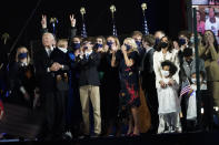President-elect Joe Biden and Vice President-elect Kamala Harris and their families, watch fireworks on stage in Wilmington, Del., Saturday, Nov. 7, 2020. (AP Photo/Paul Sancya)