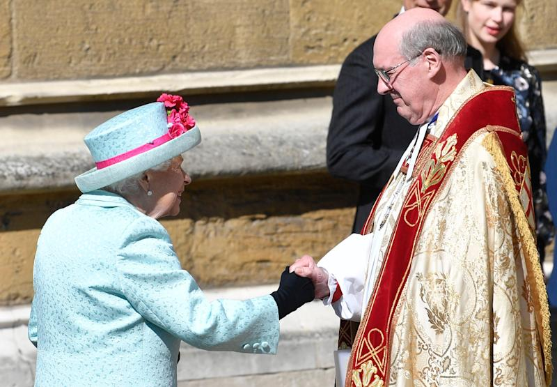 Queen Elizabeth (L) is welcomed by The Dean of Windsor David Conner (EPA)