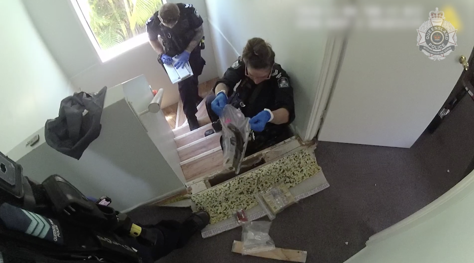 Drugs and weapons were found in the hidden compartment. Source: Queensland Police