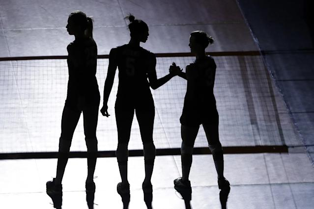 <p>United States' Karsta Lowe, left, Rachael Adams, center, and Courtney Thompson stand for introductions ahead of a women's preliminary volleyball match against China at the 2016 Summer Olympics in Rio de Janeiro, Brazil, Sunday, Aug. 14, 2016. (AP Photo/Matt Rourke) </p>