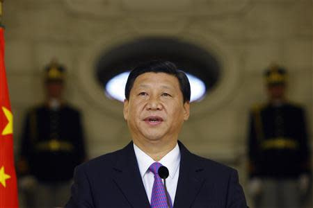 File photo of Chinese Vice President Xi delivering a speech in Bucharest