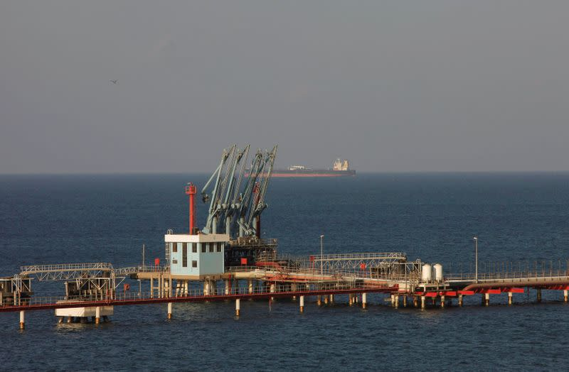 FILE PHOTO: File photo of pipelines and a loading berth of the Marsa al Hariga oil port in the city of Tobruk
