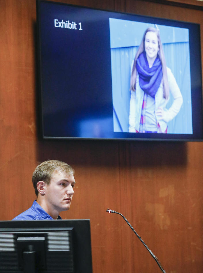 A photograph of Mollie Tibbetts is shown in the courtroom as Dalton Jack testifies during the trial of Cristhian Bahena Rivera at the Scott County Courthouse in Davenport, Iowa, on Wednesday, May 19, 2021. Rivera is charged with first-degree murder in the death of Tibbetts. Jack was Tibbetts' boyfriend at the time of her death. (Jim Slosiarek/The Gazette via AP, Pool)