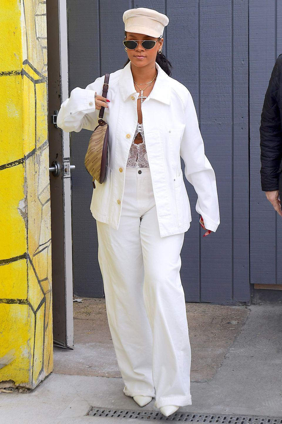 "<p>In baggy white high-waisted pants, an oversized white denim jacket, a Balenciaga bag, a newsboy cap, and <a href=""https://www.barneys.com/product/alain-mikli-nad-c3-a8ge-sunglasses-505748562.html"" rel=""nofollow noopener"" target=""_blank"" data-ylk=""slk:Alain Mikli x Alexandre Vauthier 'Nadège' sunglasses"" class=""link rapid-noclick-resp"">Alain Mikli x Alexandre Vauthier 'Nadège' sunglasses</a>.</p>"