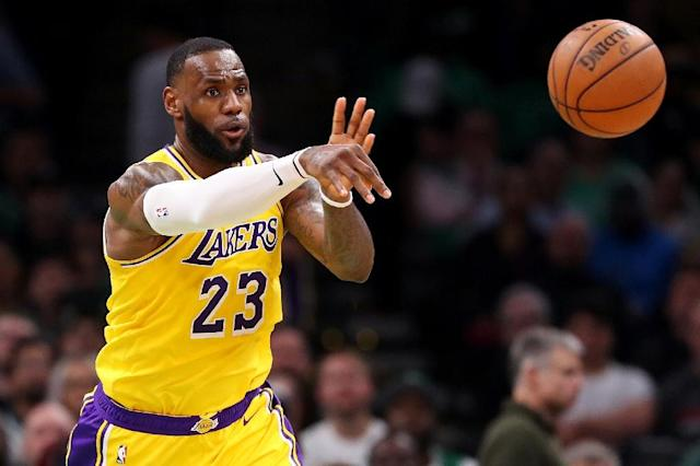 "LeBron James says he plans to play ""in as many games as possible down the stretch"" after the Lakers were officially eliminated from playoff contention (AFP Photo/Maddie MEYER)"