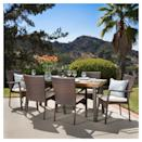 <p>You'll want to host all family celebrations with the <span>Cordella Rectangle All-Weather Wicker and Wood Patio Dining Set</span> ($800) in your backyard.</p>