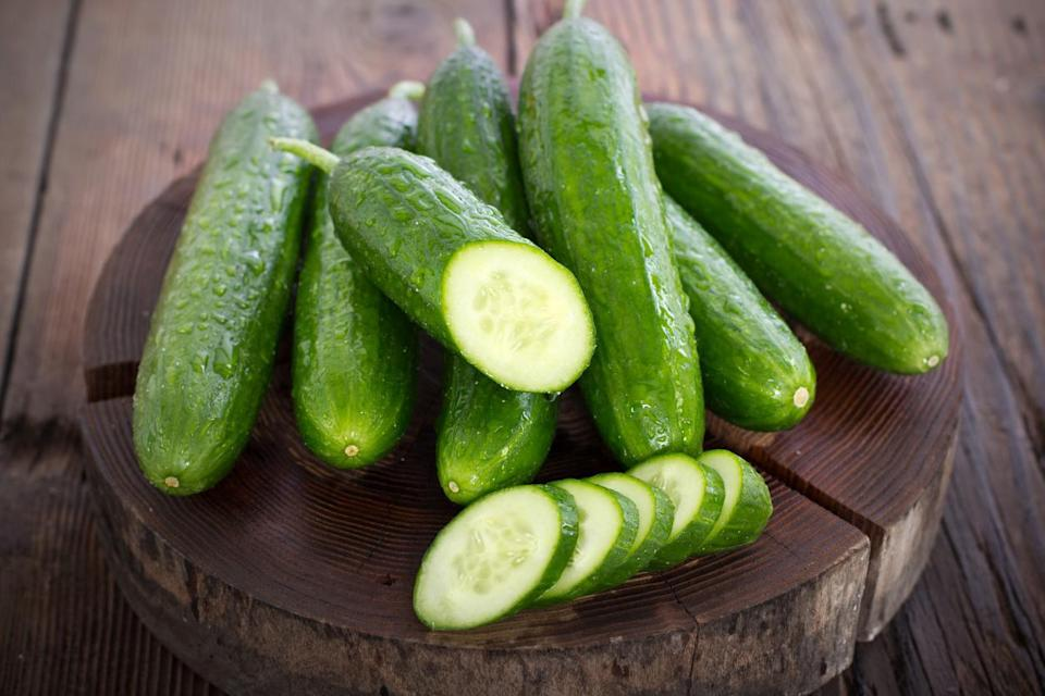 <p>Most people will store a cucumber in the grocery store's plastic bag in a drawer of their fridge. But that's actually not the best call — cucumbers are optimally kept at room temperature. If it gets below 50 degrees Fahrenheit, a cucumber can go sour more quickly. Good news is, storing cucumbers is easy. Before it's sliced open, simply place the whole vegetable on your counter, and you'll be cool. Once you slice it open, however, it needs to go in the fridge. To prevent the inside of the cucumber from drying out in the fridge, dampen a paper towel and wrap the sliced cucumber. Then, place it in a resealable plastic bag.</p>