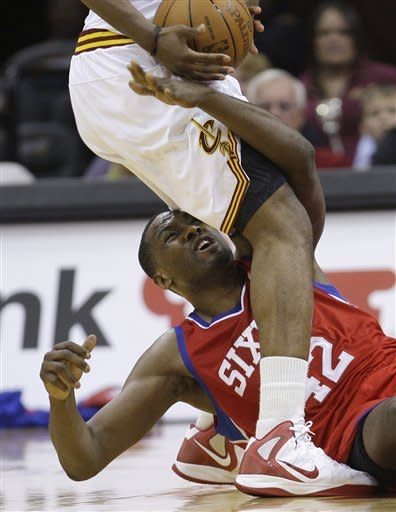 Philadelphia 76ers' Elton Brand (42) reaches up after Cleveland Cavaliers' Tristan Thompson stole the ball from Brand during the second quarter in an NBA basketball game Wednesday, April 18, 2012, in Cleveland. (AP Photo/Tony Dejak)