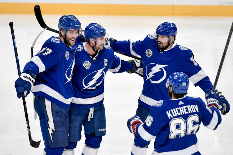Tampa celebrates after Victor Hedman, left, scored, during a NHL Global Series hockey match between the Buffalo Sabres and Tampa Bay Lightning at the Globen Arena, in Stockholm Sweden, Saturday, Nov. 9, 2019. (Jessica Gow/TT News Agency via AP)