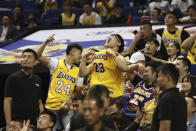 FILE - In this Thursday, Oct. 10, 2019 file photo, Chinese fans react during a preseason NBA basketball game between the Brooklyn Nets and Los Angeles Lakers at the Mercedes Benz Arena in Shanghai, China. On Thursday the Chinese government stopped NBA Commissioner Adam Silver and the teams from holding news conferences before or after the Lakers-Nets game. That was part of the Chinese response to the rift that started when Houston Rockets general manager Daryl Morey tweeted support for anti-government protesters in Hong Kong and intensified when Silver defended Morey's right to exercise free speech. (AP Photo)