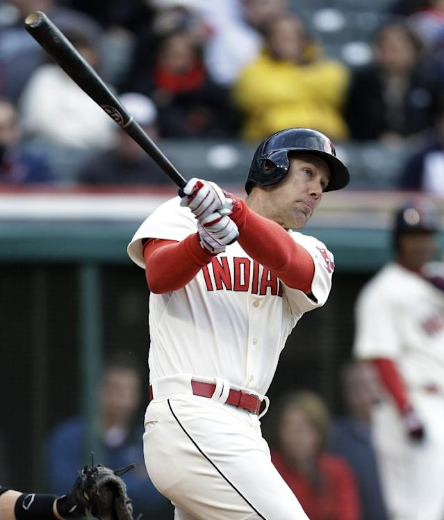 Cleveland Indians' David Murphy hits against Chicago White Sox starting pitcher Scott Carroll during the second inning of a baseball game, Saturday, May 3, 2014, in Cleveland. Murphy was safe at first base on an error by Marcus Semien. Lonnie Chisenhall scored. (AP Photo/Tony Dejak)