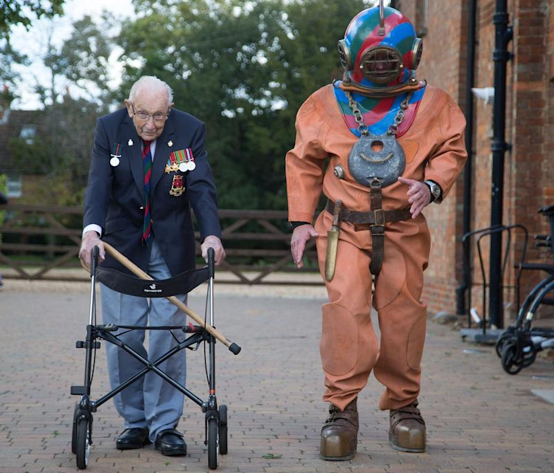 ON YOUR MARKS: Captain Sir Tom Moore is joined on his daily walk by charity fundraiser Lloyd Scott, who will next month take on the famous 3 Peaks Challenge – dressed in a deep-sea diving suit weighing 130 lbs – to raise money for disabled and disadvantaged children on behalf of the Lord's Taverners. Credit: Matt Impey/Lords Taverners