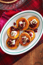"<p>Kick your butternut squash up to the next level by adding goat cheese, cranberries, and roasted pepitas.</p><p><strong><a href=""https://www.countryliving.com/food-drinks/a29628010/roasted-squash-with-goat-cheese-and-poached-cranberries-recipe/"" rel=""nofollow noopener"" target=""_blank"" data-ylk=""slk:Get the recipe"" class=""link rapid-noclick-resp"">Get the recipe</a>.</strong></p><p><strong><a class=""link rapid-noclick-resp"" href=""https://www.amazon.com/Cuisinart-Classic-Nonstick-Hard-Anodized-Saucepan/dp/B00213JO92/ref=sr_1_4?tag=syn-yahoo-20&ascsubtag=%5Bartid%7C10050.g.635%5Bsrc%7Cyahoo-us"" rel=""nofollow noopener"" target=""_blank"" data-ylk=""slk:SHOP SAUCE PANS"">SHOP SAUCE PANS</a><br></strong></p>"