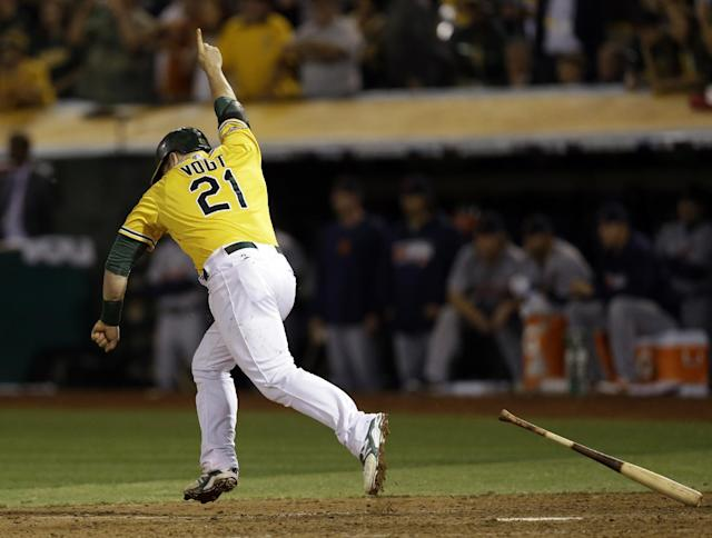Oakland Athletics Stephen Vogt makes a game winning hit in the bottom of the ninth inning of Game 2 of an American League baseball Division Series against the Detroit Tigers in Oakland, Calif., Saturday, Oct. 5, 2013.(AP Photo/Marcio Jose Sanchez)