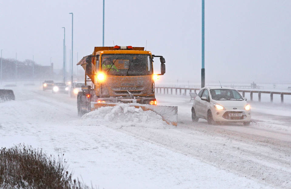 <em>Snow ploughs clear drifts on the sea front road in Whitley Bay, North Tyneside (PA)</em>