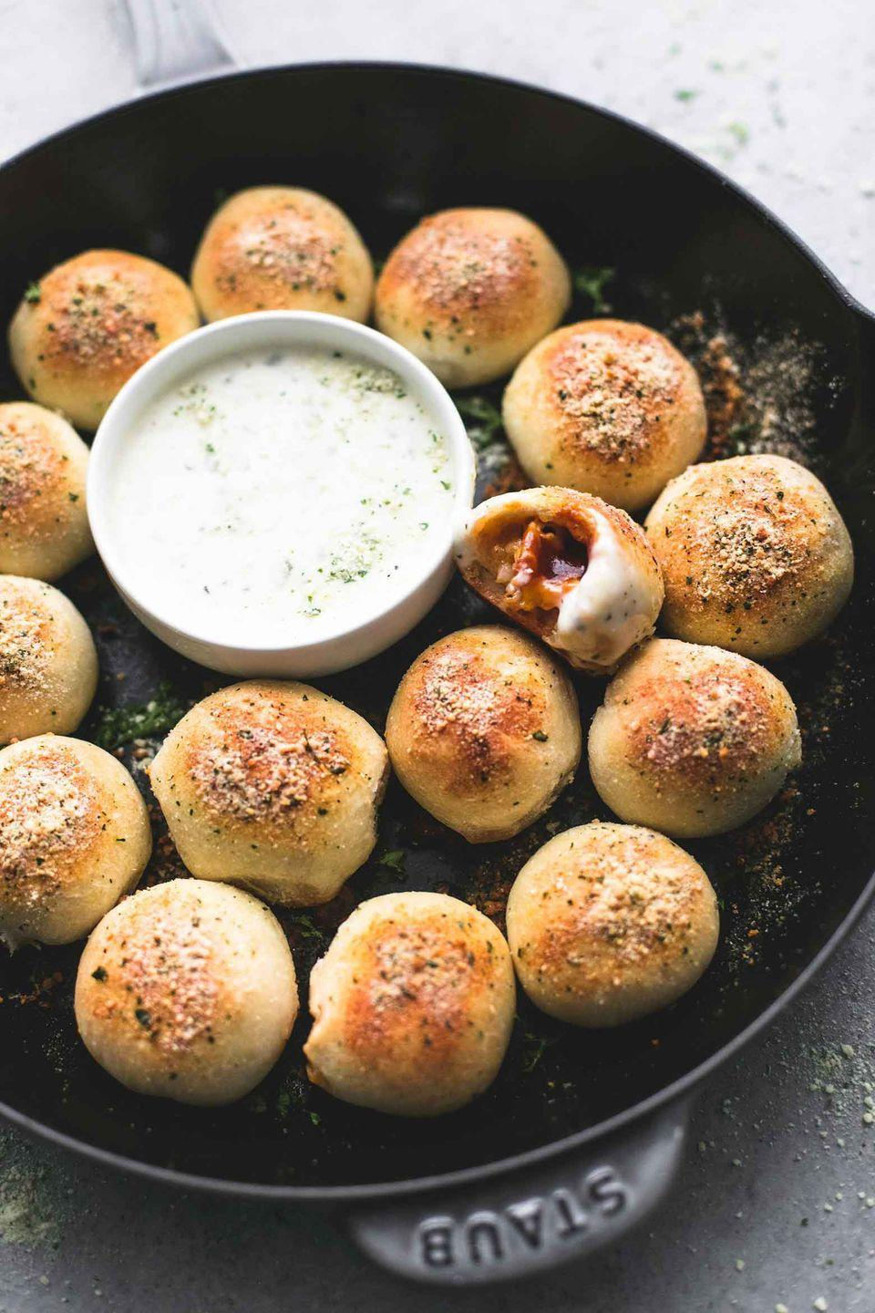 "<p>For the perfect game day finger food, look to these dough balls filled with BBQ chicken and dipped in creamy ranch.</p><p><strong>Get the recipe at <a href=""https://www.lecremedelacrumb.com/bbq-chicken-bites/"" rel=""nofollow noopener"" target=""_blank"" data-ylk=""slk:Creme de la Crumb"" class=""link rapid-noclick-resp"">Creme de la Crumb</a>.</strong></p><p><a class=""link rapid-noclick-resp"" href=""https://www.amazon.com/Red-Star-Active-Yeast-pound/dp/B003EE0CHA/?tag=syn-yahoo-20&ascsubtag=%5Bartid%7C10050.g.2966%5Bsrc%7Cyahoo-us"" rel=""nofollow noopener"" target=""_blank"" data-ylk=""slk:SHOP DRY YEAST"">SHOP DRY YEAST</a></p>"