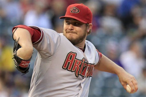 Arizona Diamondbacks starting pitcher Wade Miley winds-up to pitch Colorado Rockies' Dexter Fowler during the first inning of a baseball game Friday, Sept. 21, 2012 in Denver. (AP Photo/Barry Gutierrez)