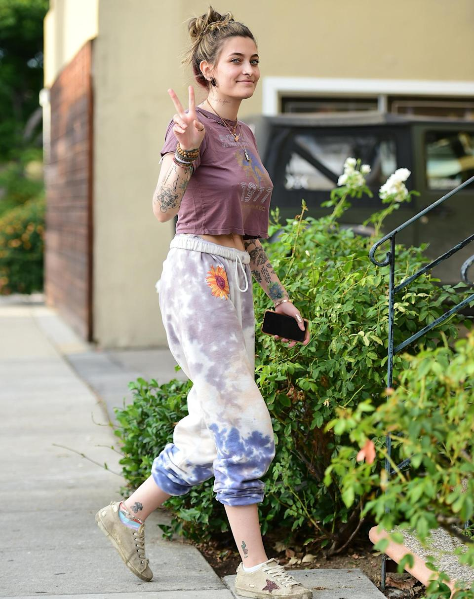 <p>Paris Jackson flashes a sign on Thursday while heading to a studio in Los Angeles.</p>