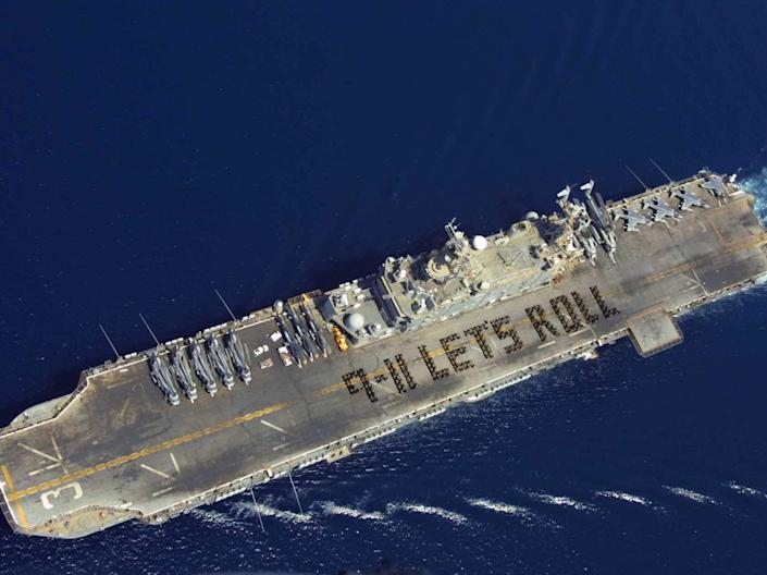 More than 500 Marines and Sailors spell out the now famous quote from Todd Beamer, on the flight deck of a ship on 6 September, 2002 (Getty Images)