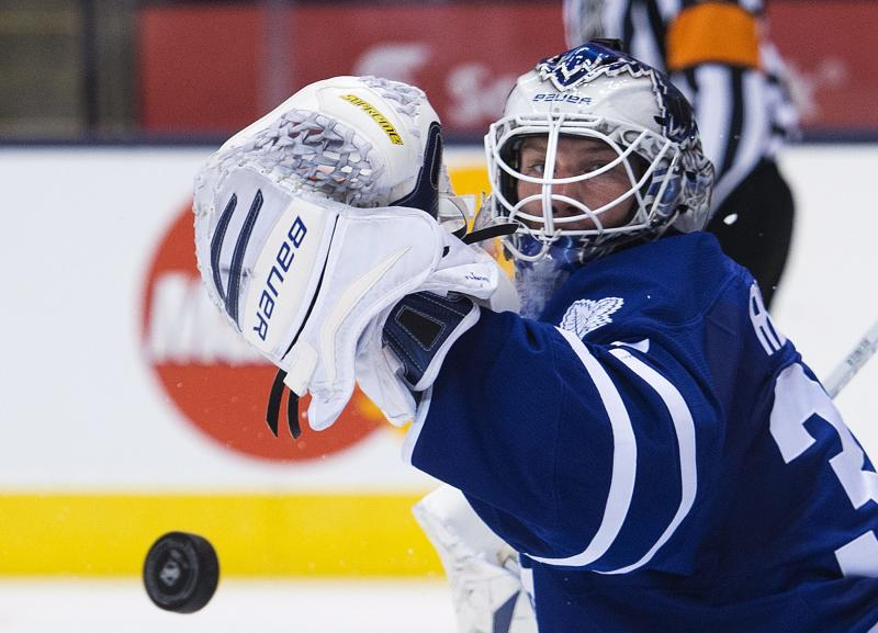 Toronto Maple Leafs goalie James Reimer makes a save against the Ottawa Senators during the first period of an NHL preseason hockey game in Toronto on Tuesday, Sept. 24, 2013. (AP Photo/The Canadian Press, Nathan Denette)