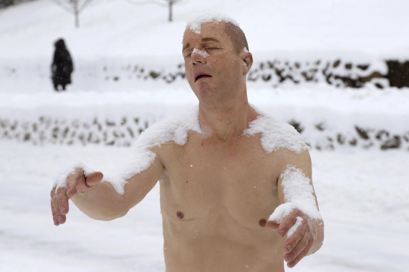 "A statue of a man sleepwalking in his underpants is surrounded by snow on the campus of Wellesley College, in Wellesley, Mass., Wednesday, Feb. 5, 2014. The sculpture entitled ""Sleepwalker"" is part of an exhibit by sculptor Tony Matelli at the college's Davis Museum. (AP Photo/Steven Senne)"
