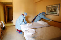 A room of the Pineta Palace Hotel gets cleaned to welcome patients recovering from COVID-19 who need to undergo quarantine, under the supervision of the Gemelli hospital, in Rome, Saturday, Nov. 14, 2020. (Cecilia Fabiano/LaPresse via AP)