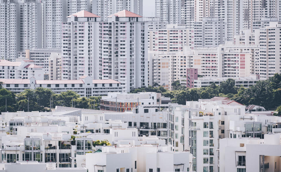 Super crowded but modern residential area in Singapore. People live in small compact smart home apartments close to the neighbour. This aerial view shows the Keppel Bay area in the southern tip of Singapore.