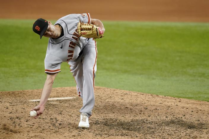 San Francisco Giants relief pitcher Tyler Rogers throws to the Texas Rangers in the ninth inning of a baseball game in Arlington, Texas, Wednesday, June 9, 2021. (AP Photo/Tony Gutierrez)