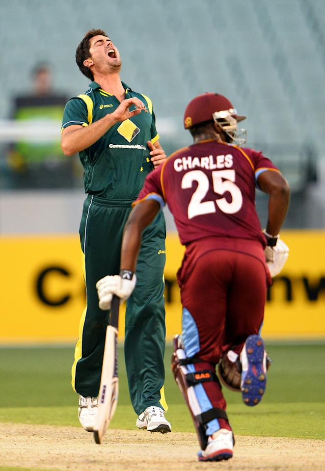 Australian bowler Ben Cutting (L) reacts as West Indies batsman Johnson Charles (R) has a lucky escape in their one-day cricket international played at the Melbourne Cricket Ground (MCG), on February 10, 2013.  AFP PHOTO/William WEST  IMAGE RESTRICTED TO EDITORIAL USE - STRICTLY NO COMMERCIAL USE        (Photo credit should read WILLIAM WEST/AFP/Getty Images)