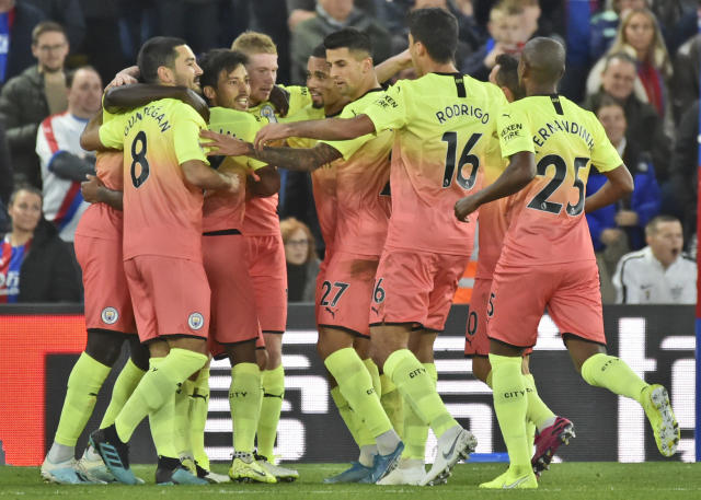 Manchester City's David Silva, centre, celebrates with teammates after scoring his side second goal during the English Premier League soccer match between Crystal Palace and Manchester City at Selhurst Park in London, England, Saturday, Oct. 19, 2019. (AP Photo/Rui Vieira)
