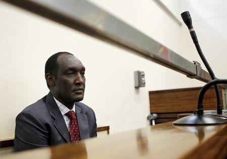 Exiled Rwandan General Faustin Kayumba Nyamwasa looks on during his court appearance in Johannesburg