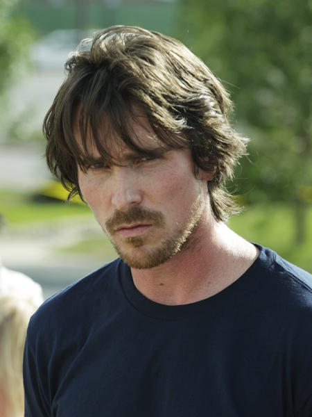 Actor Christian Bale visits a memorial to the victims of Friday's mass shooting, Tuesday, July 24, 2012, in Aurora, Colo. Twelve people were killed when a gunman opened fire during a late-night showing of the movie Dark Knight Rises, which stars Bale as Batman. (AP Photo/Ted S. Warren)