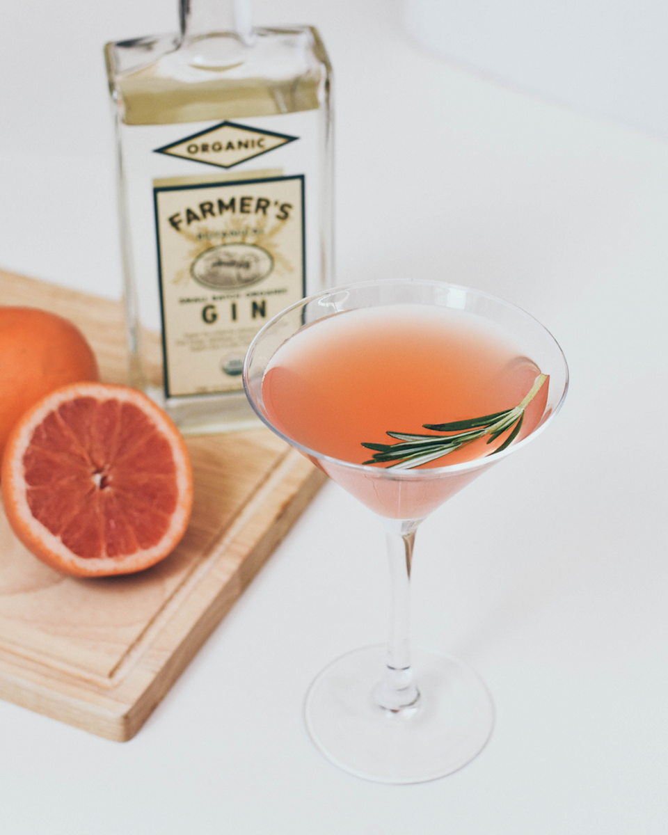 """<p><strong>Ingredients</strong></p><p>1.5 oz Farmer's Organic Gin<br>1.5 oz fresh grapefruit juice<br>.25 oz simple syrup<br>2 rosemary sprigs</p><p><strong>Instructions</strong></p><p>Saving 1 sprig of rosemary for garnish, combine all ingredients in a cocktail shaker with ice. Shake until well chilled and double strain into a martini glass. Garnish with a sprig of rosemary.</p><p><strong>More: </strong><a href=""""https://www.townandcountrymag.com/leisure/drinks/g31900654/quarantini-cocktail-recipes/"""" rel=""""nofollow noopener"""" target=""""_blank"""" data-ylk=""""slk:&quot;Quarantinis&quot; to Drink While Social Distancing"""" class=""""link rapid-noclick-resp"""">""""Quarantinis"""" to Drink While Social Distancing</a></p>"""