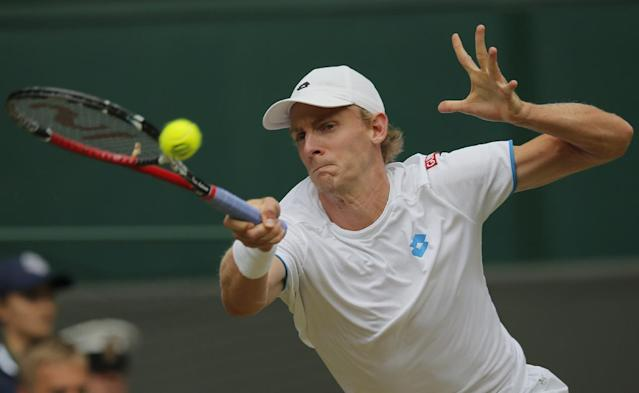 Kevin Anderson of South Africa plays a return to Andy Murray of Britain during their men's singles match at the All England Lawn Tennis Championships in Wimbledon, London, Monday, June 30, 2014. (AP Photo/Pavel Golovkin)