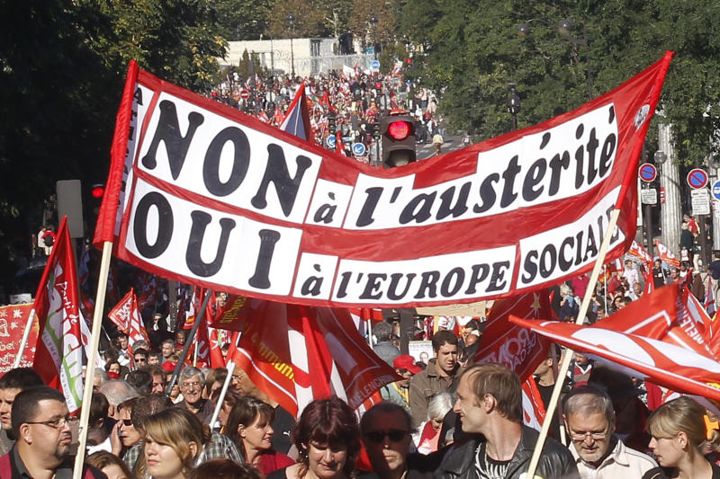 """Demonstrators march during a rally holding a banner which reads,""""no to the austerity, yes to the the social Europe"""", to protest against the austerity measures announced by the French government, in Paris, Sunday, Sept 30, 2012. (AP Photo/Michel Euler)"""