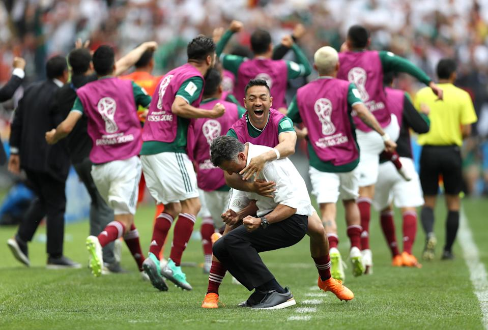 <p>Juan Carlos Osorio, Manager of Mexico celebrates with Marco Fabian of Mexico after their sides first goal during the 2018 FIFA World Cup Russia group F match between Germany and Mexico at Luzhniki Stadium on June 17, 2018 in Moscow, Russia. (Photo by Clive Rose/Getty Images) </p>