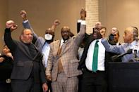 George Floyd's brother Philonise Floyd, flanked by activist Reverend Al Sharpton and Floyd family attorney Ben Crump