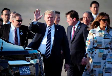 U.S. President Donald Trump waves as he arrives at the Haneda International Airport in Tokyo