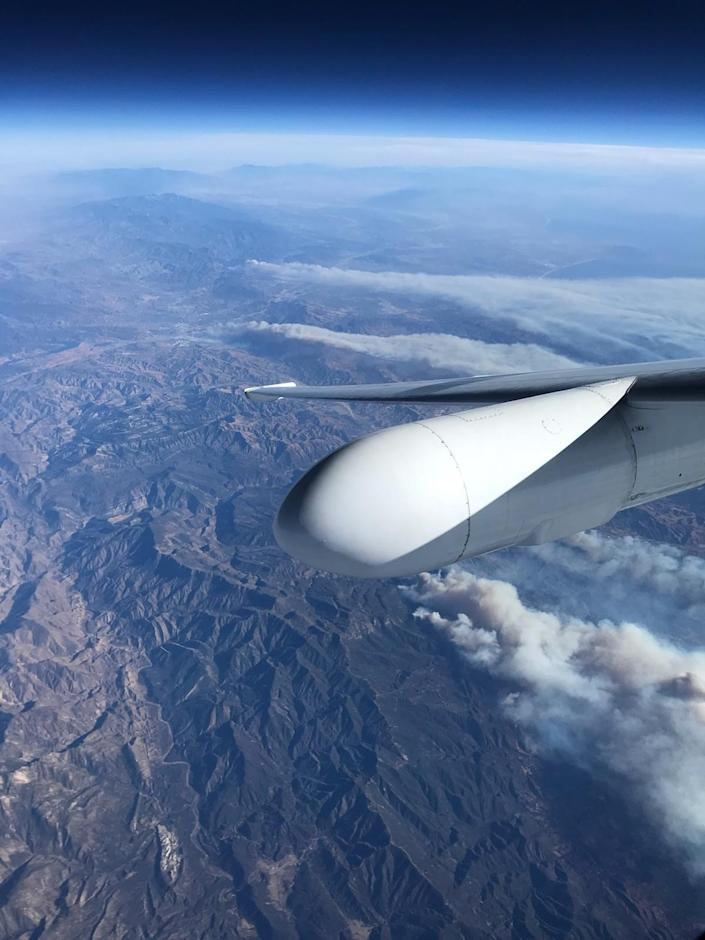 <p>A view from NASA Armstrong Flight Research Center's ER-2 aircraft shows smoke plumes, from roughly 65,000 feet, produced by the Thomas Fire in Ventura County, California, around 1 p.m. PST on Dec. 5, 2017. (Photo: NASA/Stu Broce) </p>