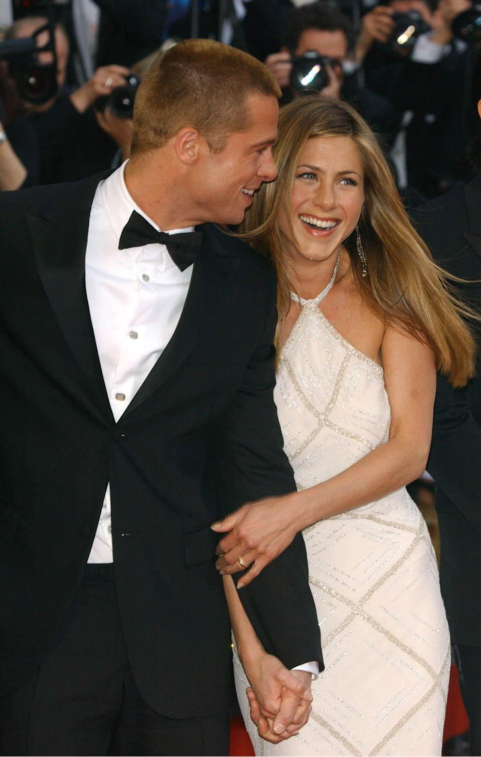 Star of the film Brad Pitt and his wife Jennifer Aniston arrive for the premiere of Troy, at the Palais de Festival during the 57th Cannes Film Festival in France.   (Photo by Ian West - PA Images/PA Images via Getty Images)