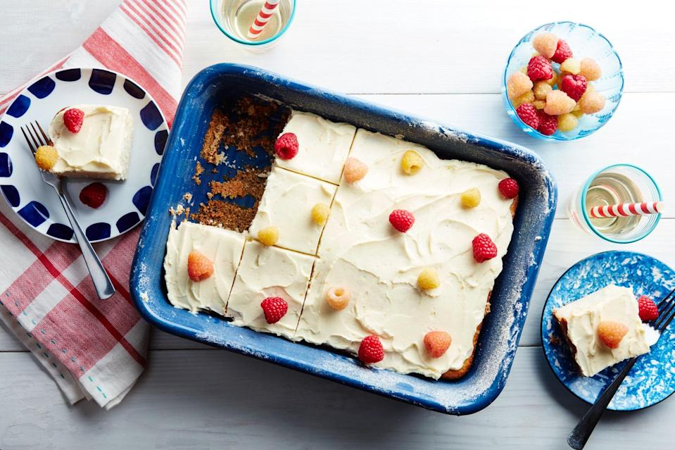 """A little orange juice (and zest) wakes up the icing of this crowd-pleasing cake. Swirl it on and top with raspberries and edible flowers. Who needs cake mix when your cake recipe's this easy? <a href=""""https://www.epicurious.com/recipes/food/views/vanilla-buttermilk-sheet-cake-with-raspberries-and-orange-cream-cheese-frosting?mbid=synd_yahoo_rss"""" rel=""""nofollow noopener"""" target=""""_blank"""" data-ylk=""""slk:See recipe."""" class=""""link rapid-noclick-resp"""">See recipe.</a>"""