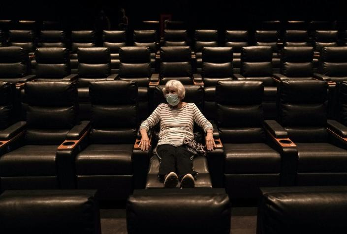 """<span class=""""caption"""">Most people are avoiding movie theaters, even as restrictions have eased.</span> <span class=""""attribution""""><a class=""""link rapid-noclick-resp"""" href=""""https://newsroom.ap.org/detail/APTOPIXVirusOutbreakCalifornia/50bf49f19c274c71855daadc572a32e4/photo?Query=regal%20AND%20cinemas&mediaType=photo&sortBy=arrivaldatetime:desc&dateRange=Anytime&totalCount=11215&currentItemNo=2"""" rel=""""nofollow noopener"""" target=""""_blank"""" data-ylk=""""slk:AP Photo/Jae C. Hong"""">AP Photo/Jae C. Hong</a></span>"""