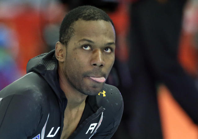 Shani Davis of the U.S. looks up at the screen to see his performance timing after the second heat of the men's 500-meter speedskating race at the Adler Arena Skating Center during the 2014 Winter Olympics, Monday, Feb. 10, 2014, in Sochi, Russia. (AP Photo/Matt Dunham)
