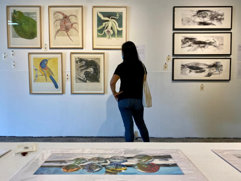 A visitor admiring the artwork during the exhibition at Hin Bus Depot. — Pictures by Steven Ooi KE