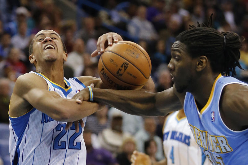 New Orleans Hornets guard Brian Roberts (22) gets fouled by Denver Nuggets forward Kenneth Faried (35) in the first half of an NBA basketball game in New Orleans, Monday, March 25, 2013. (AP Photo/Bill Haber)