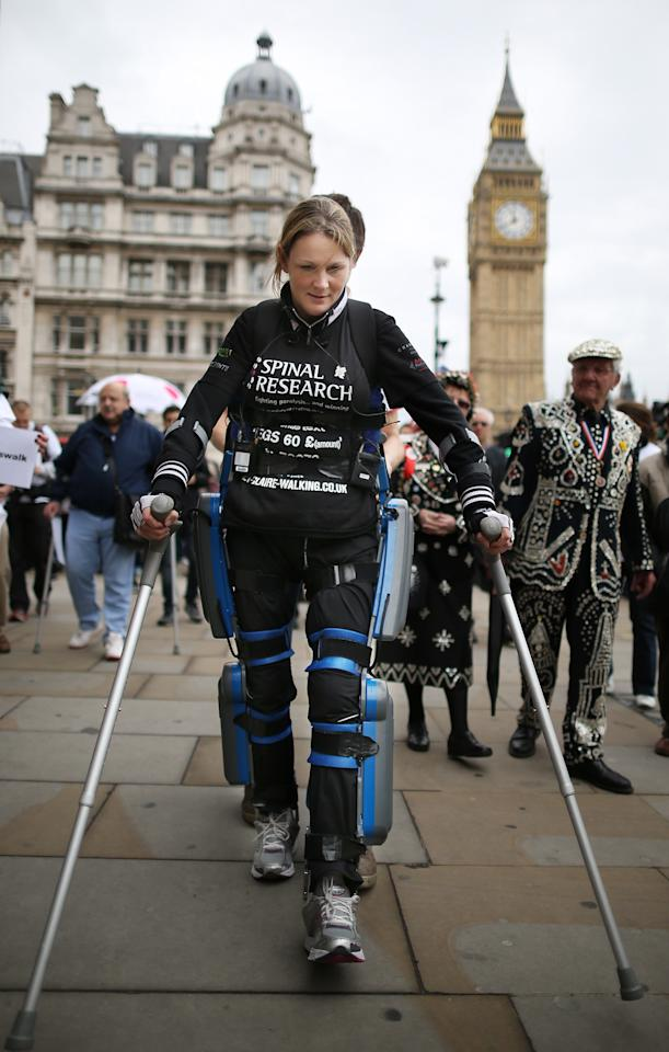 LONDON, ENGLAND - MAY 08:  Claire Lomas walks the last mile of the London Marathon on May 8, 2012 in London, England. Ms Lomas, who is paralysed from the waist down after a riding accident in 2007, has taken 16 days to complete the 26.2 mile route. Starting out with 36,000 other runners she has averaged 2 miles a day with the help of a bionic ReWalk suit.  (Photo by Peter Macdiarmid/Getty Images)