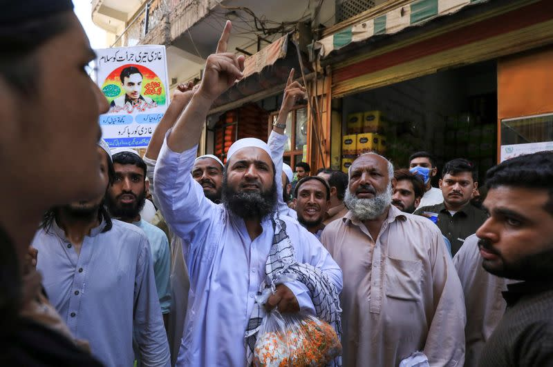 People chant slogans in favour of a man who, according to the Pakistani police, is suspected of killing U.S. national Tahir Ahmed Naseem during a proceeding at a judicial complex, in a protest rally demanding his release, in Peshawar,