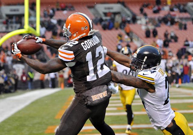 Cleveland Browns wide receiver Josh Gordon (12) catches a 1-yard touchdown pass against Pittsburgh Steelers cornerback Ike Taylor in the fourth quarter of an NFL football game Sunday, Nov. 24, 2013. (AP Photo/David Richard)