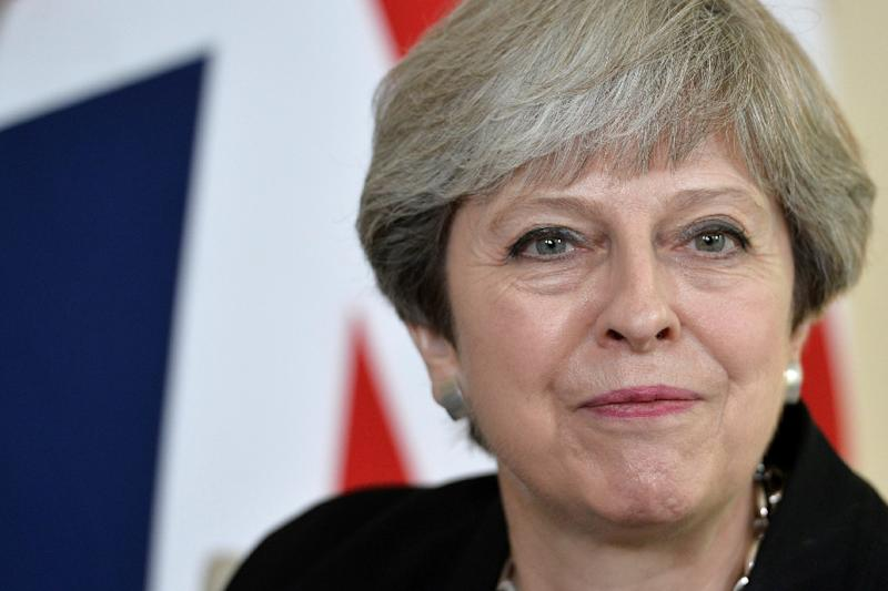 British Prime Minister Theresa May's government has been forced into a series of embarrassing U-turns and her gamble of holding an early election backfired spectacularly (AFP Photo/Hannah McKay)